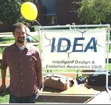 A friendly IDEA Club member with one of the high quality vinyl signs we provide to each club.